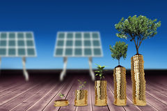 Composite image of tree and plant over gold coins 3d Stock Photography