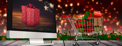 Composite image of trolley full of gifts Stock Photography