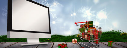 Composite image of trolley full of gifts Royalty Free Stock Image