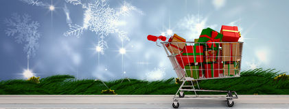Composite image of trolley full of gifts Stock Photo