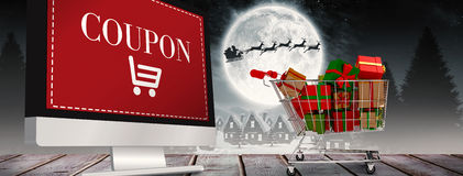 Composite image of trolley full of gifts Stock Image