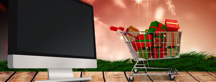 Composite image of trolley full of gifts Stock Images