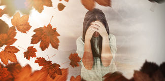 Composite image of troubled woman crying Royalty Free Stock Images