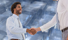 Composite image of two businessmen shaking hands in office. Two businessmen shaking hands in office against abstract square design Royalty Free Stock Photography