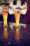 Composite image of two cocktail glasses ready to serve on bar counter Stock Photos