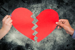 Composite image of two hands holding broken heart Stock Photos