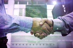 Composite image of two men shaking hands Royalty Free Stock Images