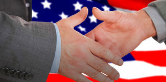 Composite image of two people going to shake their hands Stock Image