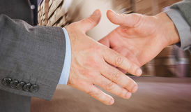 Composite image of two people going to shake their hands Royalty Free Stock Photo