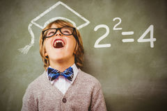 Composite image of two squared. Two squared against boy laughing in front of blackboard Stock Photos