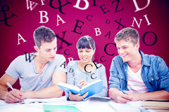 Composite image of two students getting help from a female student Royalty Free Stock Photography