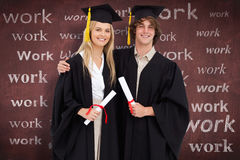 Composite image of two students in graduate robe shoulder to shoulder Royalty Free Stock Photos
