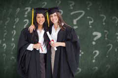 Composite image of two women embracing each other after they graduated from university Royalty Free Stock Images