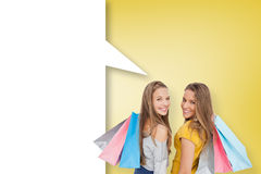 Composite image of two young women with shopping bags with speech bubble Stock Photos
