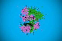 Composite image of typewriter on paint splashes Royalty Free Stock Photography