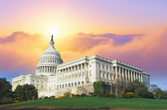Composite image of the U.S. Capitol and blue sky with sunset behind the dome Royalty Free Stock Images