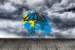 Composite image of umbrella on paint splashes Royalty Free Stock Photography