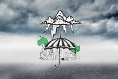 Composite image of umbrella sheltering city doodle Royalty Free Stock Images