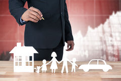 Composite image of underwriter drawing a family stock image