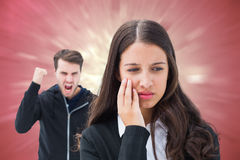 Composite image of unhappy brunette being threatened by boyfriend Stock Images