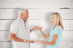 Composite image of unhappy couple having an argument Stock Images
