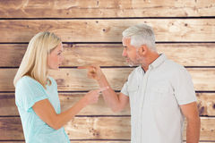 Composite image of unhappy couple having an argument Royalty Free Stock Photos