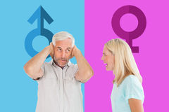 Composite image of unhappy couple having an argument with man not listening Royalty Free Stock Photo