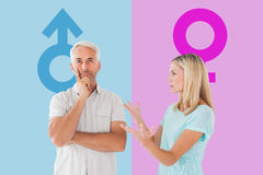 Composite image of unhappy couple having an argument with man not listening Stock Photo
