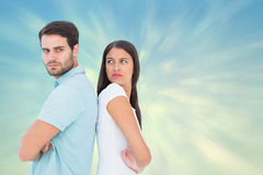 Composite image of unhappy couple not speaking to each other Stock Images