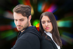 Composite image of unhappy couple not speaking to each other Royalty Free Stock Photos