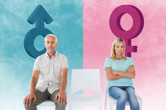 Composite image of unhappy couple not speaking to each other. Unhappy couple not speaking to each other  against pink and blue Stock Photo