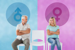 Composite image of unhappy couple not speaking to each other Royalty Free Stock Image