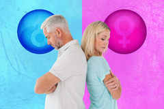 Composite image of unhappy couple not speaking to each other Royalty Free Stock Photo