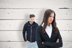 Composite image of unhappy couple not speaking to each other Stock Photo