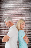 Composite image of unhappy couple not speaking to each other Stock Photography