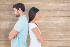 Composite image of unhappy couple not speaking to each other Royalty Free Stock Photography