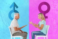 Composite image of unhappy couple sitting on chairs having an argument Stock Photo