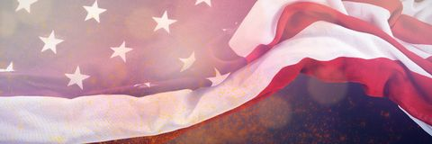 Composite image of united states flag. United States flag against green background with vignette Stock Images