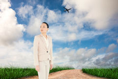 Composite image of unsmiling asian businesswoman Royalty Free Stock Image