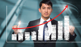 Composite image of unsmiling businessman holding Royalty Free Stock Photos