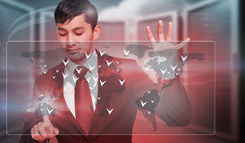 Composite image of unsmiling businessman holding and pointing Royalty Free Stock Photo