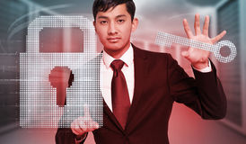 Composite image of unsmiling businessman holding and pointing Stock Photography