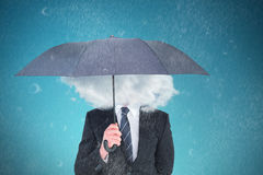 Composite image of unsmiling businessman sheltering under umbrella. Unsmiling businessman sheltering under umbrella against blue vignette background Stock Photos