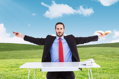 Composite image of unsmiling businessman sitting with arms outstretched. Unsmiling businessman sitting with arms outstretched against blue sky over green field Royalty Free Stock Photography