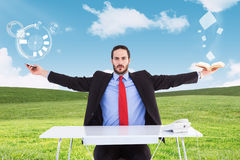 Composite image of unsmiling businessman sitting with arms outstretched. Unsmiling businessman sitting with arms outstretched against blue sky over green field Stock Photos