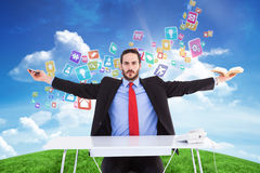 Composite image of unsmiling businessman sitting with arms outstretched Royalty Free Stock Images