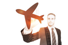 Composite image of unsmiling businessman in suit pointing up his finger. Unsmiling businessman in suit pointing up his finger against airplane Royalty Free Stock Image