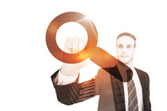 Composite image of unsmiling businessman in suit pointing up his finger. Unsmiling businessman in suit pointing up his finger against magnifying glass Stock Image