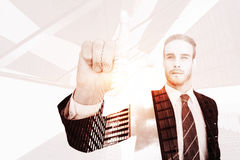 Composite image of unsmiling businessman in suit pointing up his finger. Unsmiling businessman in suit pointing up his finger against skyscraper Royalty Free Stock Photo