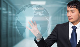 Composite image of unsmiling businessman touching Royalty Free Stock Image